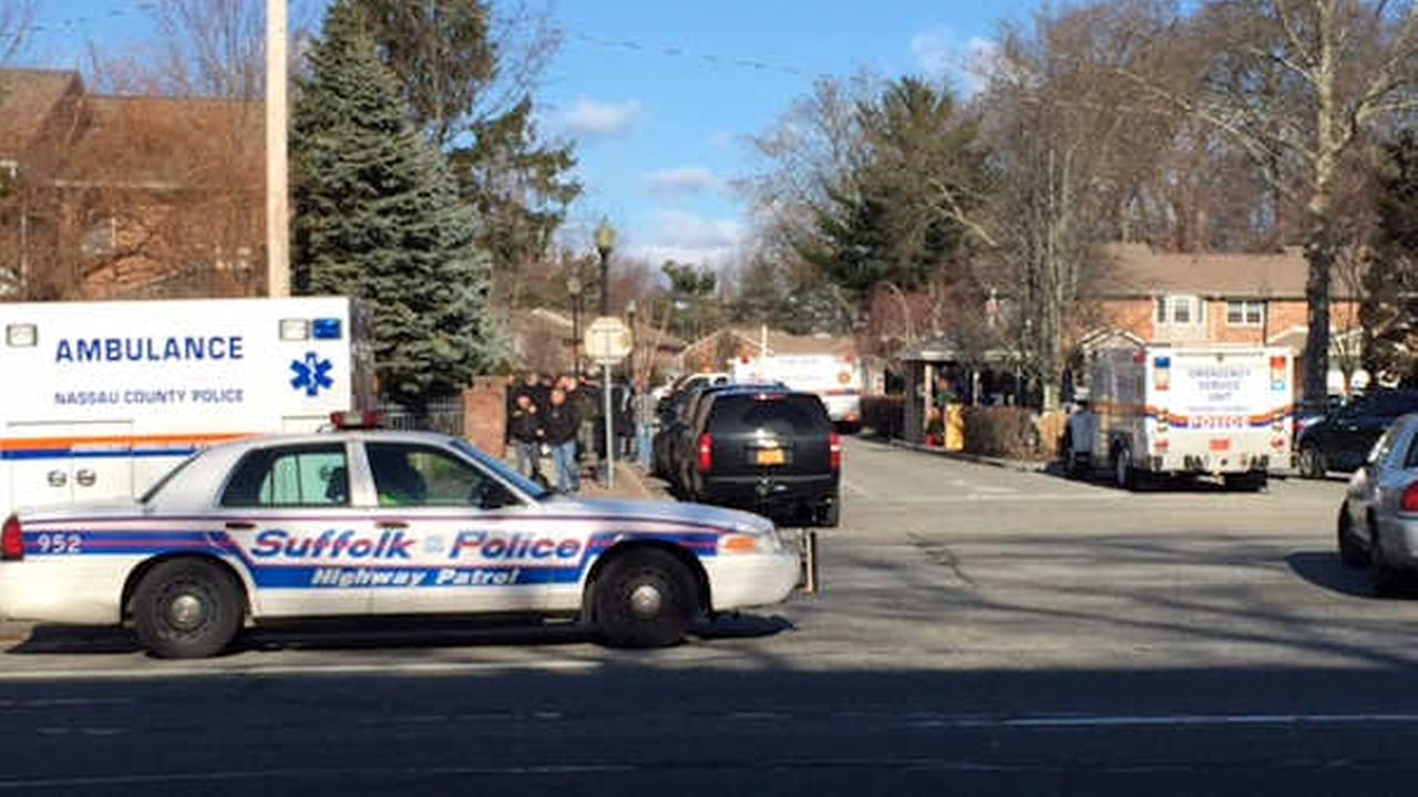 Police searching a Woodbury neighborhood for the last remaining bank robbery suspect.