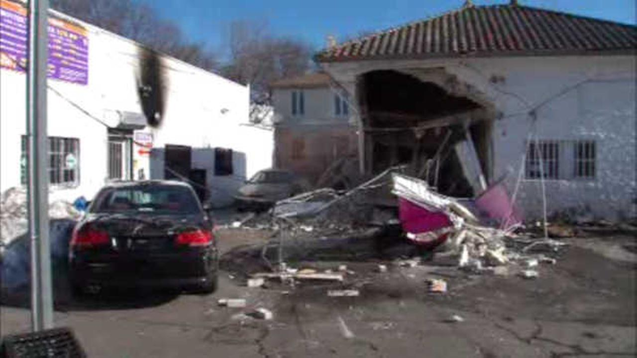 Woman hurt after crashing van into Queens car detailing center