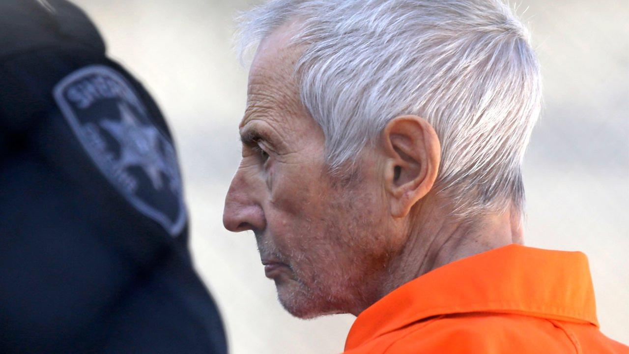 Robert Durst is escorted into Orleans Parish Prison after his arraignment in Orleans Parish Criminal District Court in New Orleans, Tuesday, March 17, 2015.
