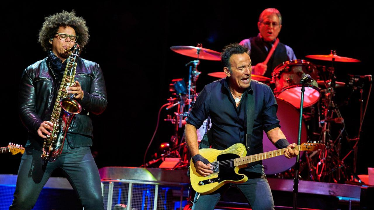 Bruce Springsteen, center, Max Weinberg, and Jake Clemons, left, perform with the E Street Band at Madison Square Garden, Wednesday, Jan. 27, 2016, in New York.