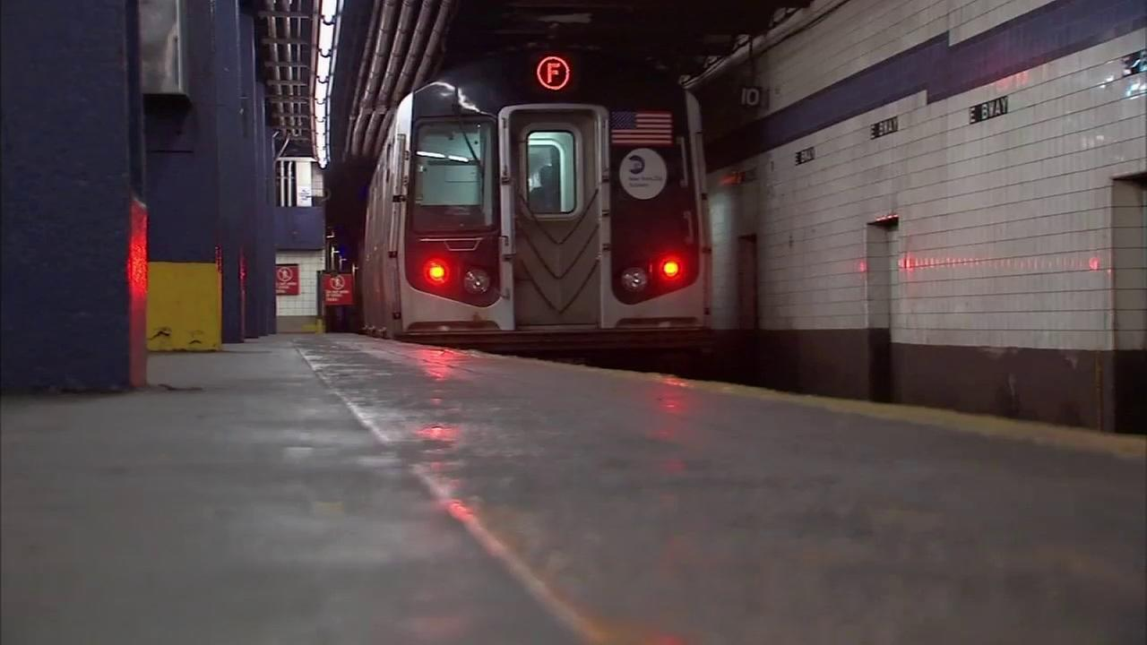Subway rider dragged to death after caught in F train doors in Queens