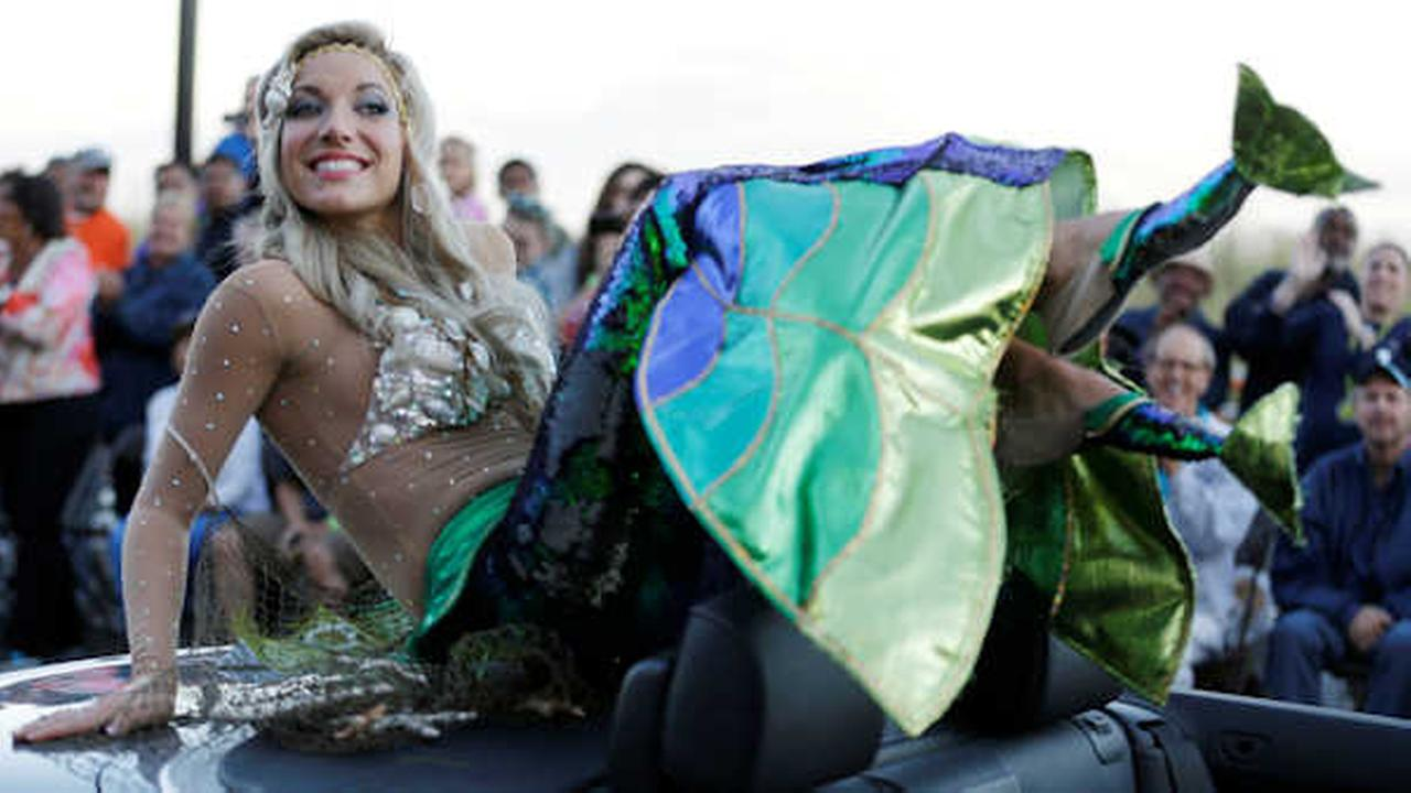 Cara McCollum displays her shoes during the Miss America Shoe Parade at the Atlantic City boardwalk, Sept. 14, 2013, in Atlantic City, N.J. (AP Photo/Julio Cortez)