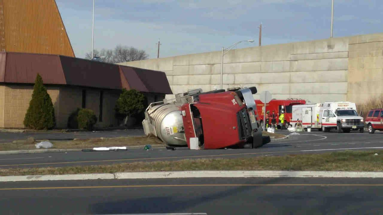 Tanker truck flips over in Raritan, New Jersey, causing road closures and evacuations