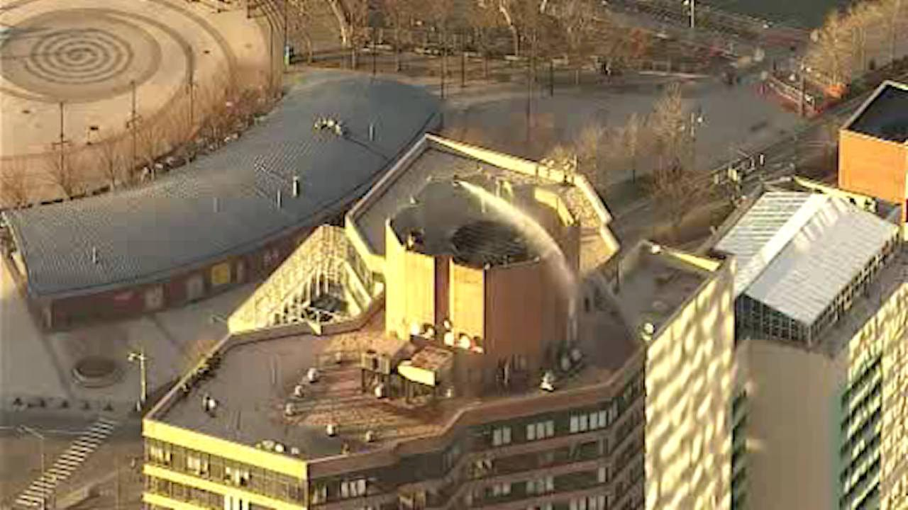 Firefighters battle blaze atop 40-story Midtown apartment complex