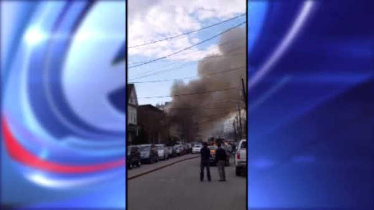 Three-alarm fire tearing through two buildings in Elizabeth, New Jersey