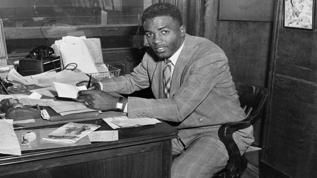 Jackie Robinson, first African American to ever be admitted into the major leagues, photographed right after he signed his contract with the Brooklyn Dodgers at the Dodgers office.