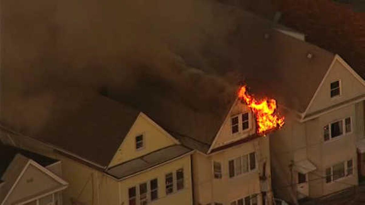 Firefighters battle 3-alarm fire burning through house in Bayonne