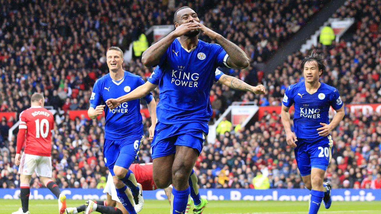 Leicesters Wes Morgan, centre, celebrates after scoring during the English Premier League soccer match between Manchester United and Leicester at Old Trafford Stadium, Manchester.