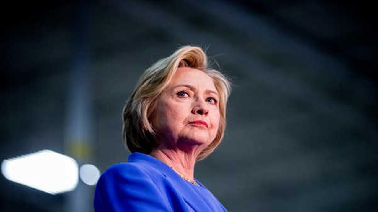 Hillary Clinton stands on stage at the Union of Carpenters and Millwrights Training Center during a campaign stop in Louisville, Ky. Sunday.  (AP Photo/Andrew Harnik)