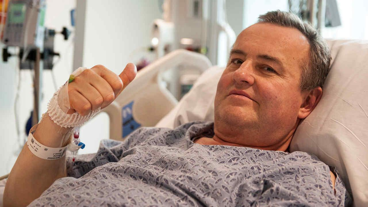 Thomas Manning gives a thumbs up after being asked how he was feeling following the first penis transplant in the US, in Boston