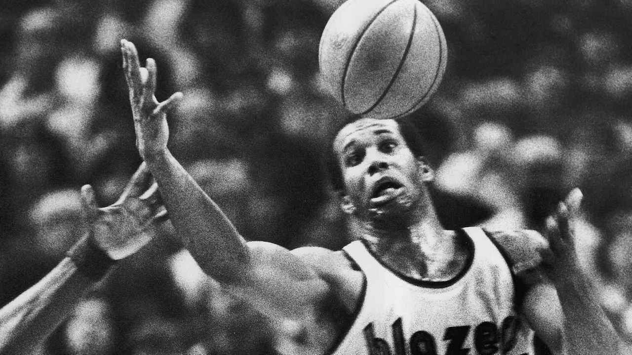 In this Dec. 25, 1979, file photo, Portland Trail Blazers Kermit Washington gains control of a loose ball during an NBA basketball game against the Golden State Warriors