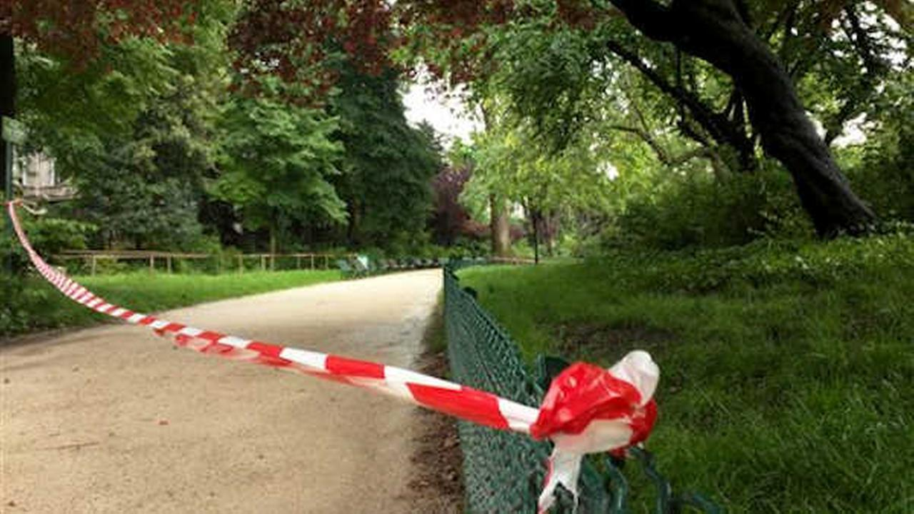 White-and-red tape is strung across a sandy pathway through Park Monceau after a lightning stike, in Paris.  (AP Photo/Raphael Satter)