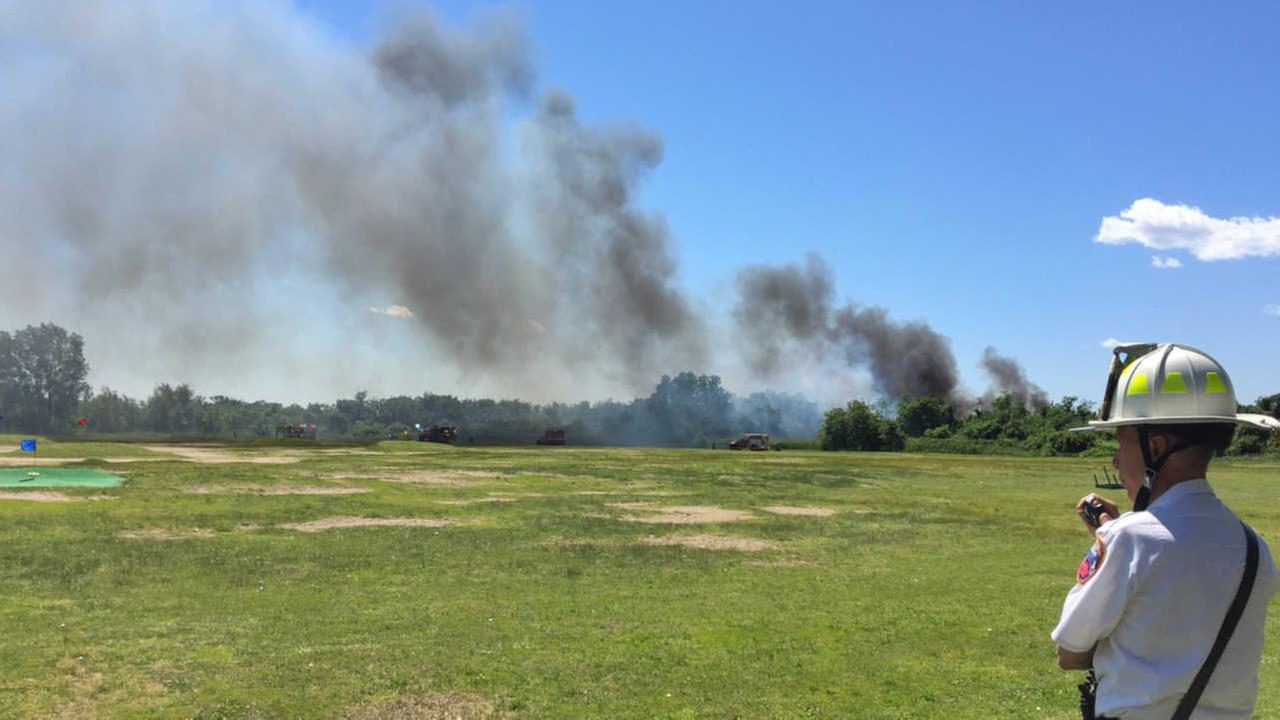 7-alarm brush fire along Belt Parkway is contained
