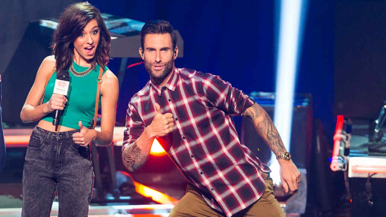The Voice Season 6 contestant Christina Grimmie with her coach on the Voice and Maroon 5 vocalist Adam Levine at the iHeartRadio Theater on Tuesday, August 26, 2014.