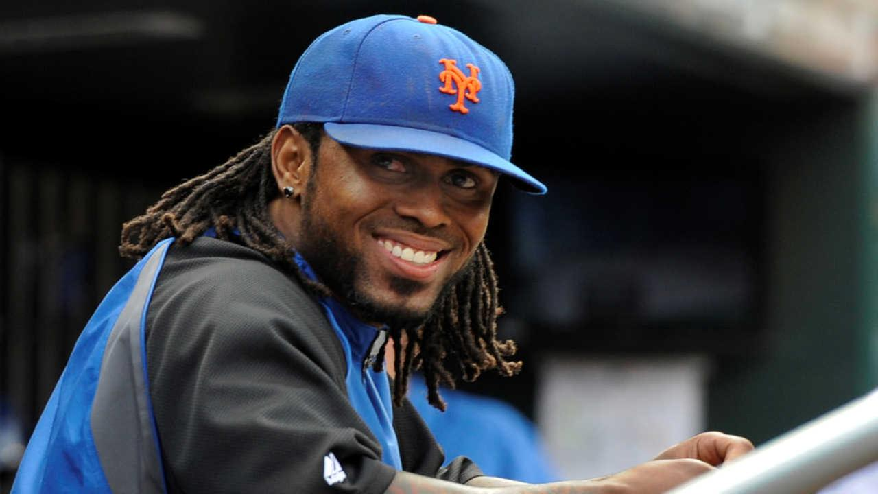 FILE - In this Sept. 28, 2011, file photo, New York Mets Jose Reyes smiles in the dugout in the ninth inning of a baseball game against the Cincinnati Reds in New York.