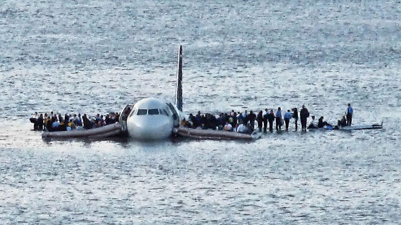 In this Thursday Jan. 15, 2009 photo, airline passengers wait to be rescued on the wings of a US Airways Airbus 320 jetliner that safely ditched in the frigid waters of the Hudson.
