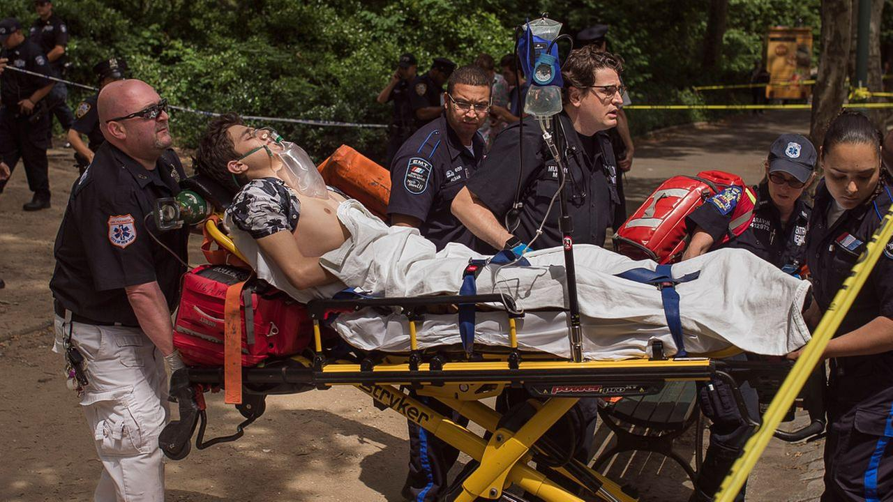 A injured man is carried to an ambulance in Central Park in New York, Sunday, July 3, 2016.