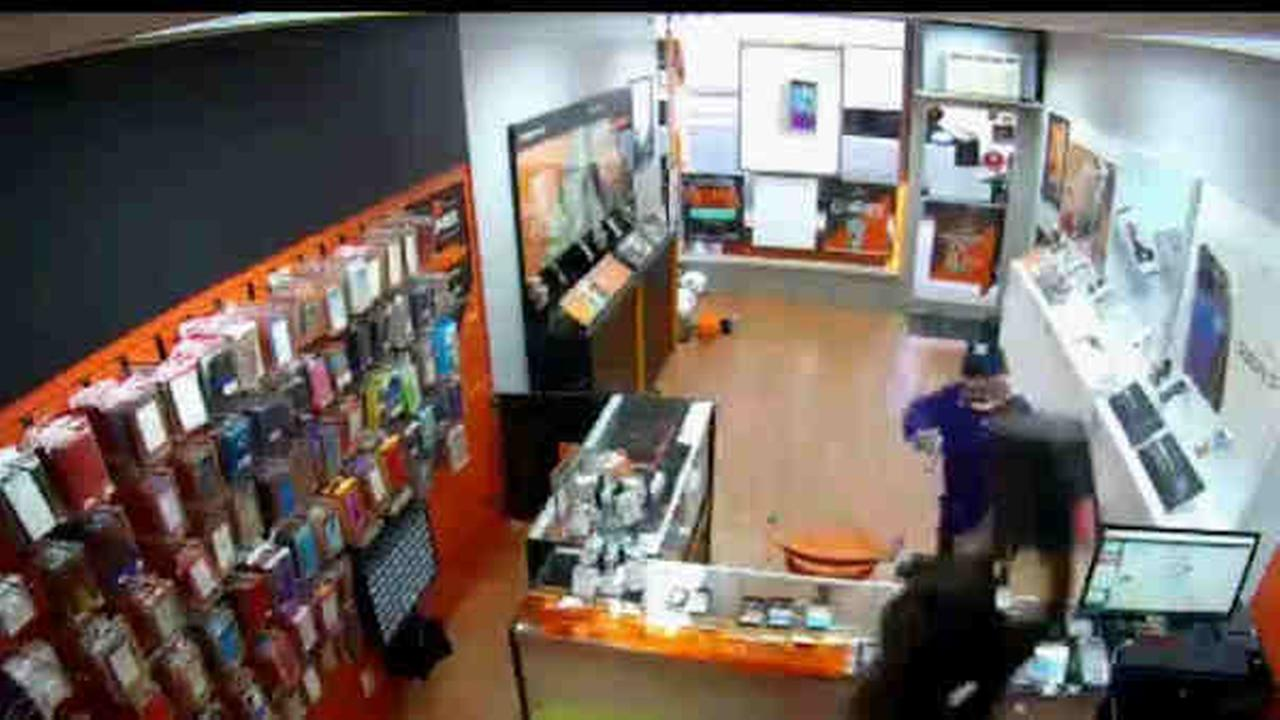 An employee at a Bronx Boost phone store threw items at an armed robber to scare him off.