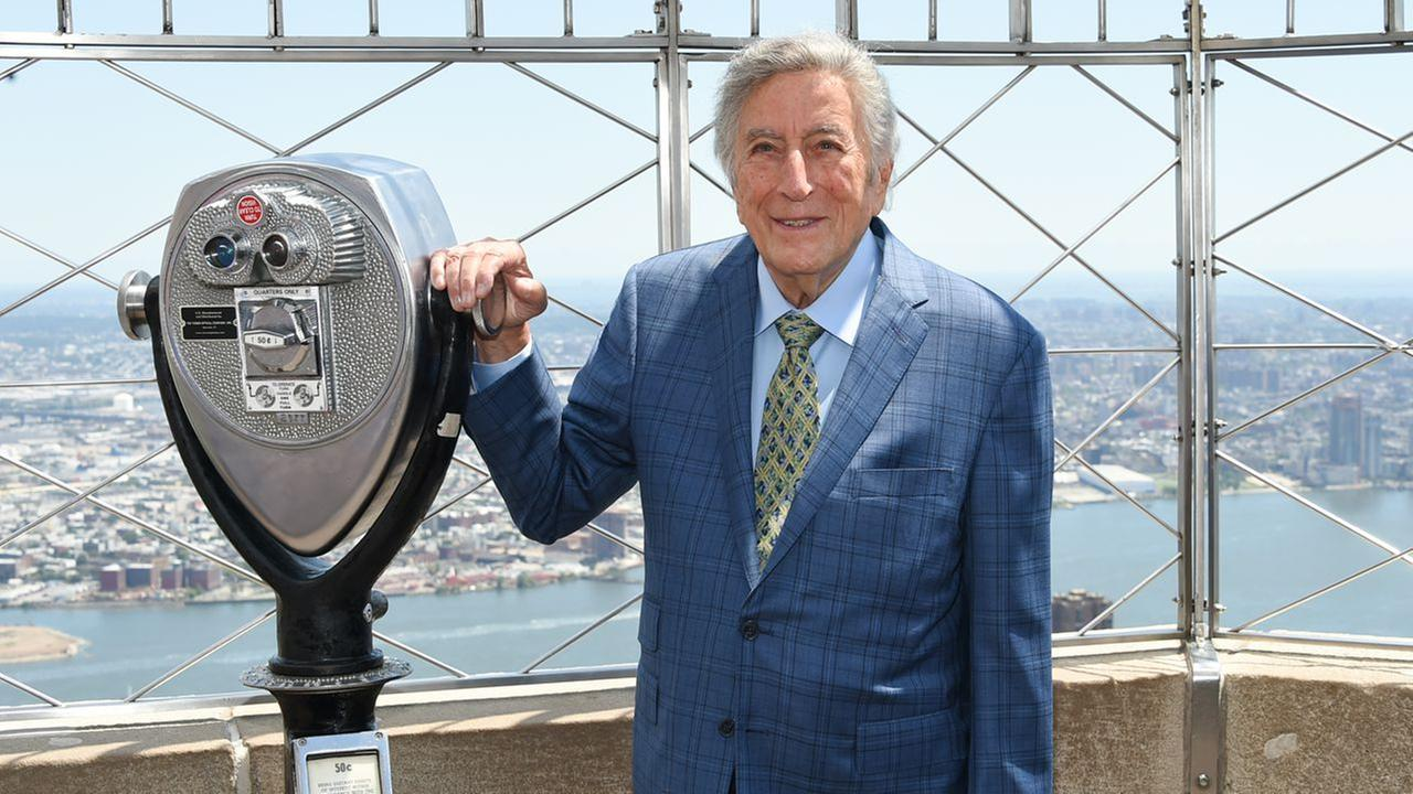 Singer Tony Bennett poses on the 86th floor observatory after lighting the Empire State Building in honor of his 90th birthday on Wednesday, Aug. 3, 2016, in New York.