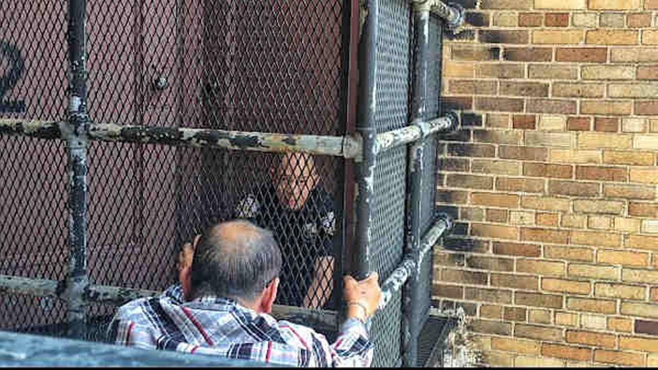 Man suspected in death of Flushing woman talked from ledge by NYPD officer.