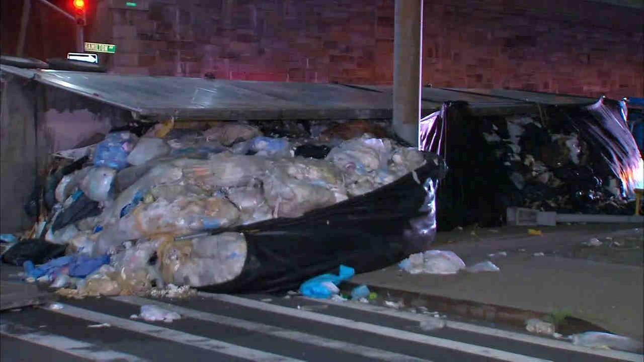 A tractor-trailer overturned in Brooklyn, spilling trash onto local streets in the Gowanus section of Brooklyn.