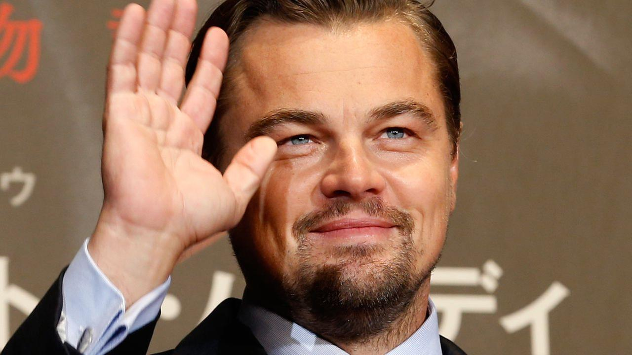 American actor Leonardo DiCaprio waves for fans during the Japan premiere of his new movie The Revenant in Tokyo, Japan, Wednesday, March 23, 2016.