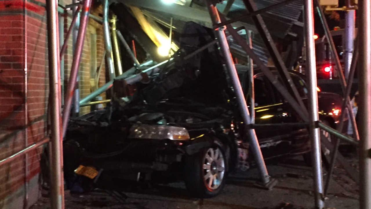 Several injured, including a child when car crashes into Harlem scaffolding