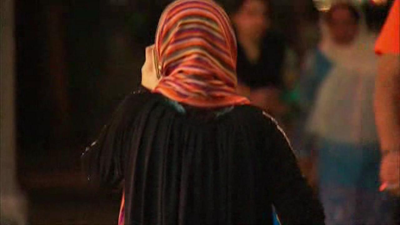 Woman wearing Muslim garb says blouse set on fire while walking in Midtown
