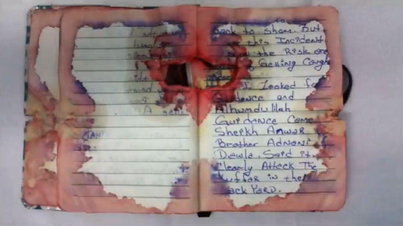 Photo, details of suspected bomber's bloodied, bullet-ridden journal released