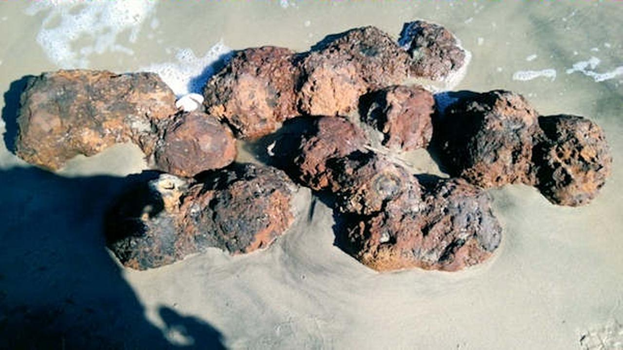 This photo provided by by the Charleston County Sheriffs Office shows Civil War-era cannonballs found Sunday, Oct. 9, 2016, on a beach in Folly Beach, South Carolina