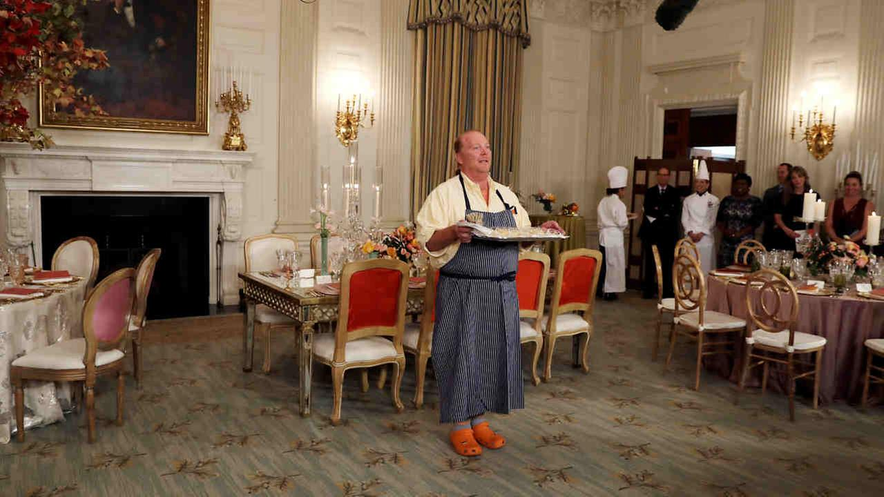 American chef Mario Batali holds a tray of pasta during a preview in advance of the State Dinner in honor of the Official Visit of Italian Prime Minister Matteo Renzi and his wife.