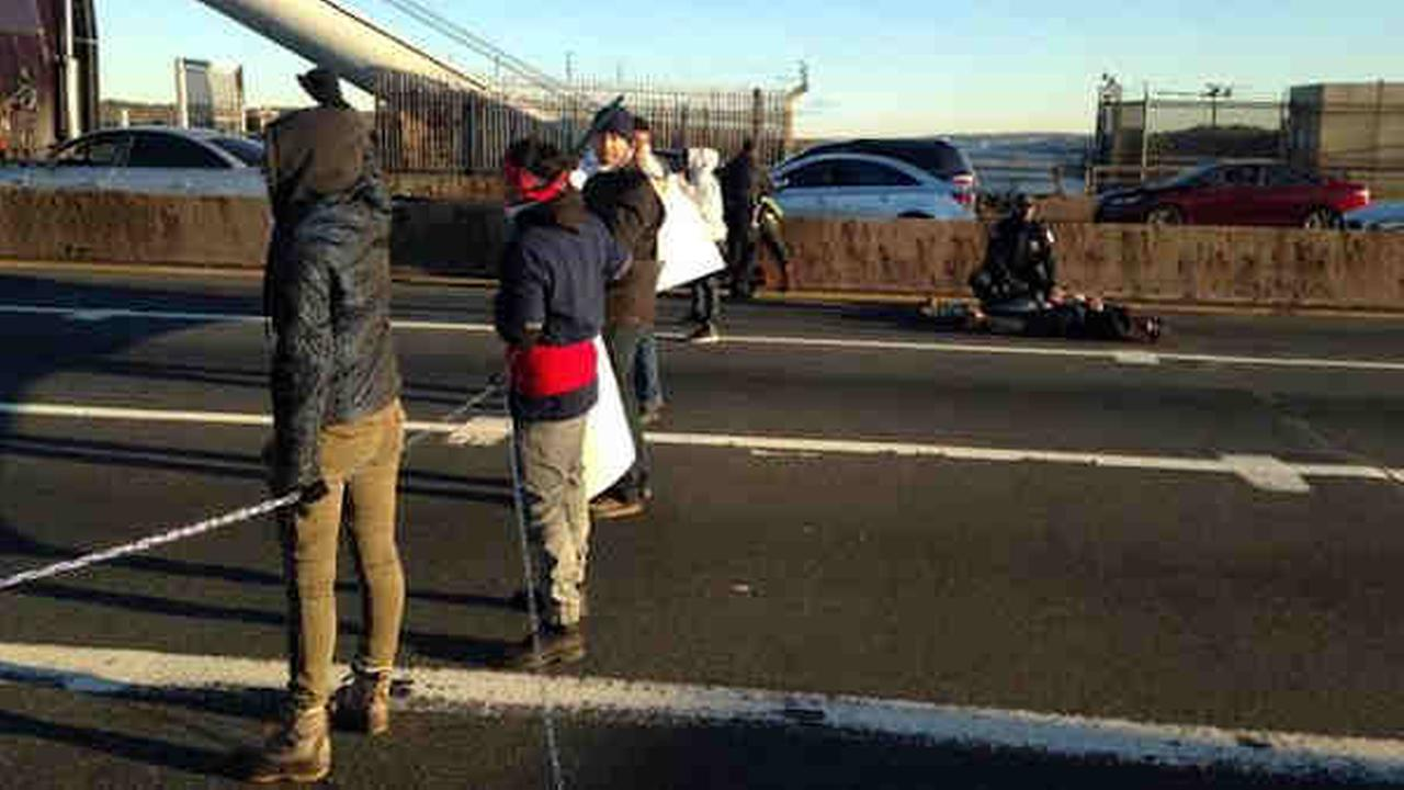 Protesters blocked the upper level of the George Washington Bridge Wednesday morning during rush hour.