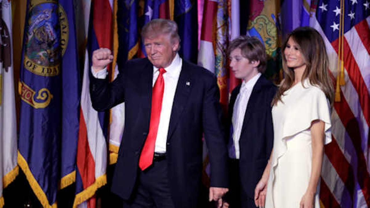 Donald Trump after giving his acceptance speech as his wife Melania and their son Barron follow him during his election night rally,  (AP Photo/John Locher)