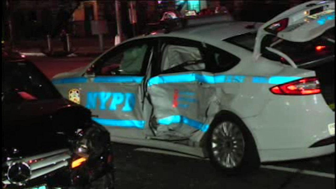 3-car crash involving NYPD vehicle in Harlem