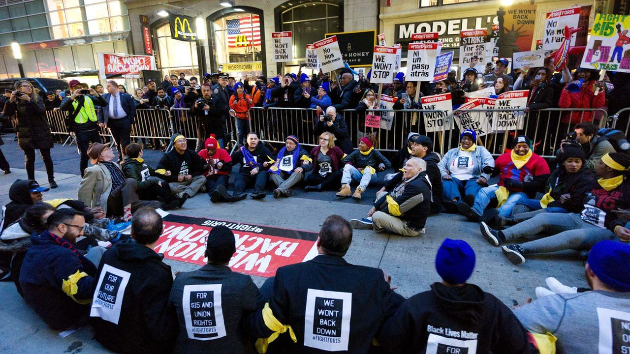 A crowd of about 350 protesters stand on Broadway in front of a McDonalds restaurant, Tuesday, Nov. 29, 2016, in New York.