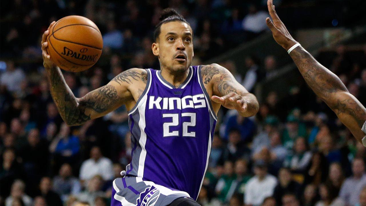 Sacramento Kings Matt Barnes (22) goes up to shoot against Boston Celtics Jae Crowder, right, during the third quarter of an NBA basketball game in Boston, Friday, Dec. 2, 2016.