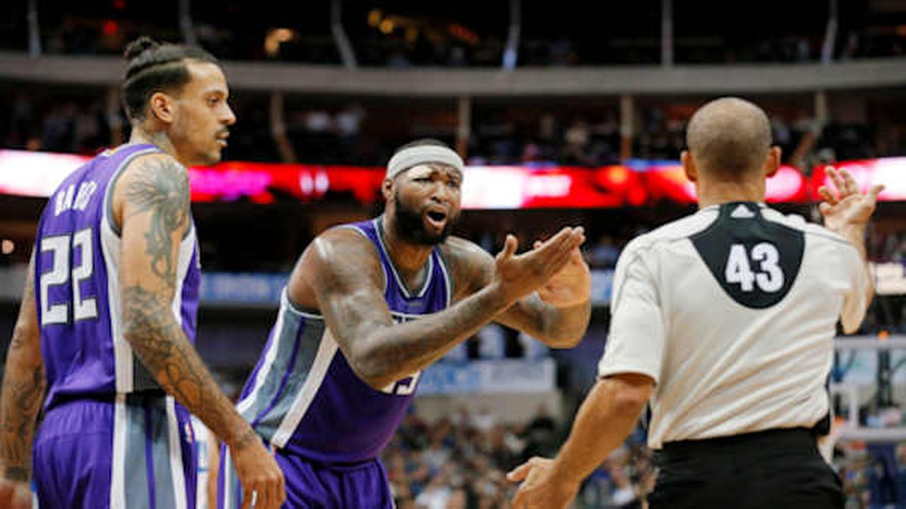 acramento Kings Matt Barnes (22) and DeMarcus Cousins, center, argue call with referee Dan Crawford  (AP Photo/Tony Gutierrez)
