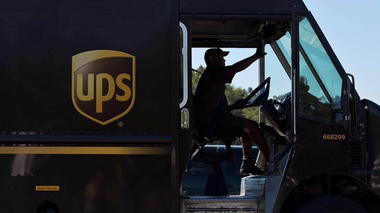 In this Sept. 23, 2014, file photo, a United Parcel Service truck driver enters a company warehouse in Birmingham, Ala.