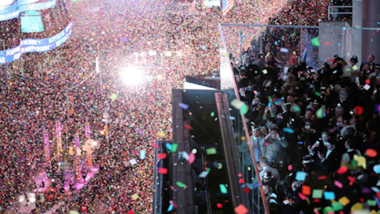 In this Jan. 1, 2016, file photo, revelers celebrate as confetti flies over New Yorks Times Square after the clock strikes midnight (AP Photo/Mary Altaffer, File)