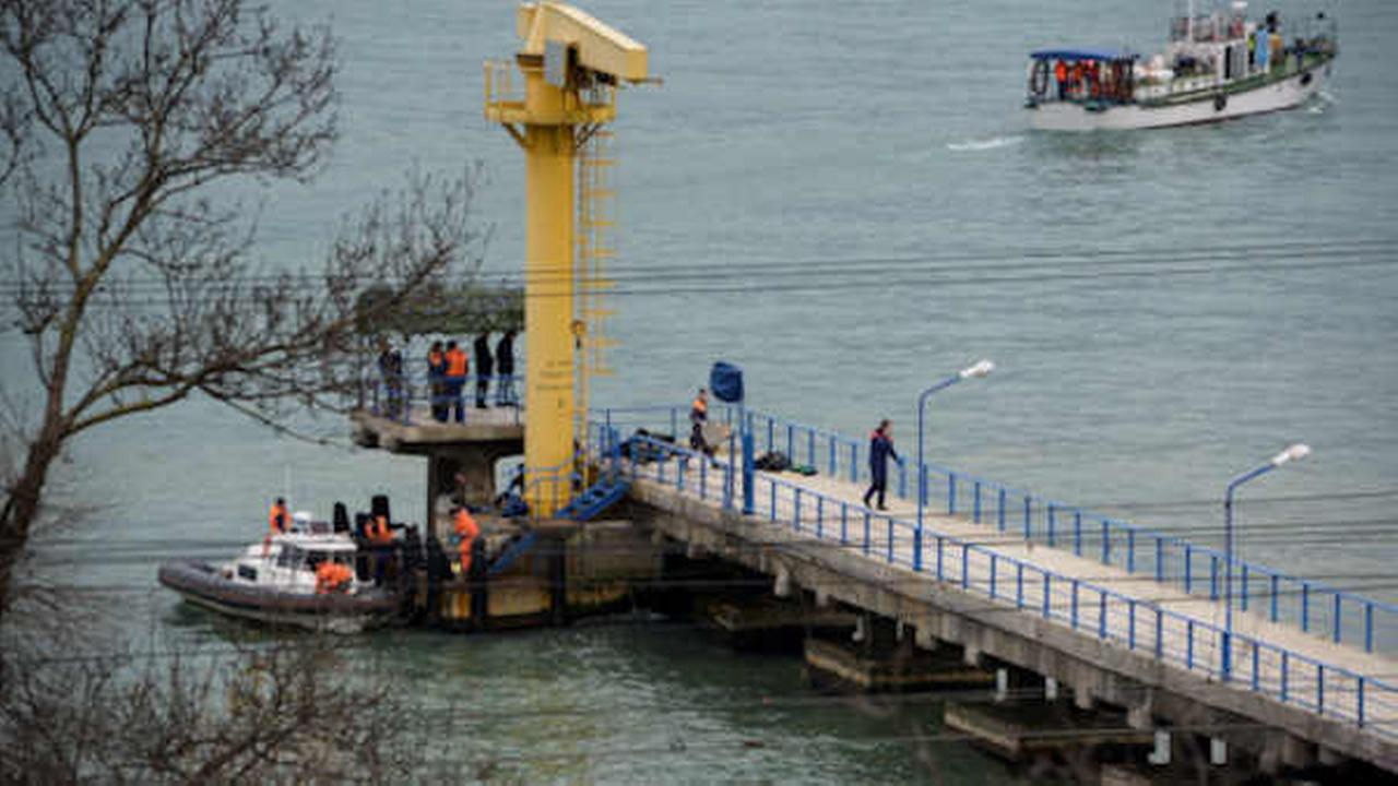 Russian rescue workers collect wreckage of the crashed plane at a pier just outside Sochi, Russia, (AP Photo/Viktor Klyushin)