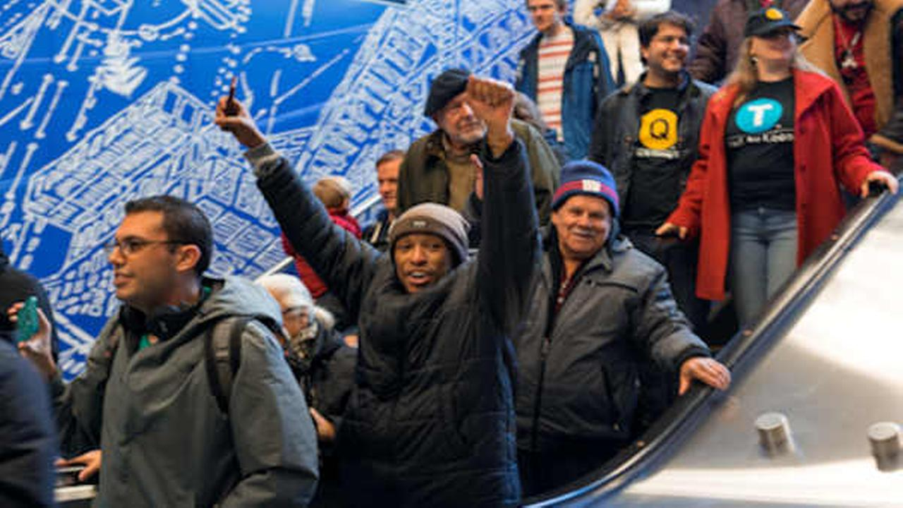 A person cheers as he enters the 96th Street station in New York Sunday  (AP Photo/Craig Ruttle)