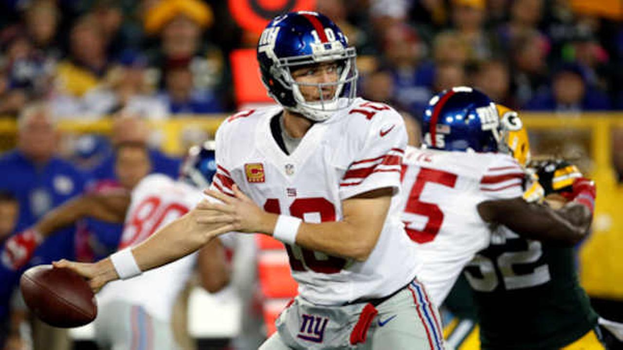 In this Oct. 9, 2016, file photo, New York Giants Eli Manning throws during the first half of a game against the Green Bay Packers   (AP Photo/Mike Roemer, File)