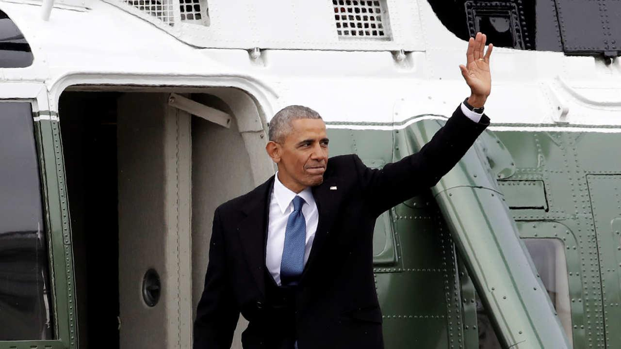 Former President Barack Obama waves as he boards a Marine helicopter during a departure ceremony on the East Front of the U.S. Capitol in Washington, Friday, Jan. 20, 2017.