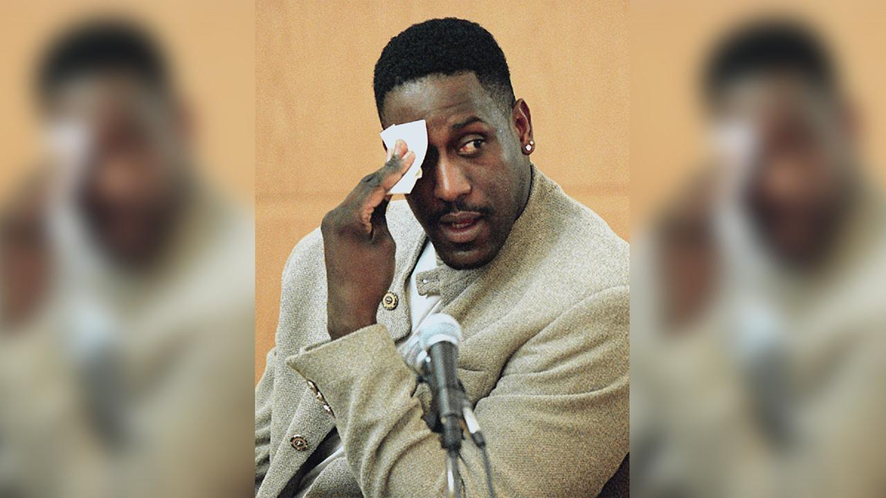In this Dec. 4, 2000, photo, former NC State basketball star Charles Shackleford wipes his forehead as he answers questions during Rae Carruths murder trial in Charlotte