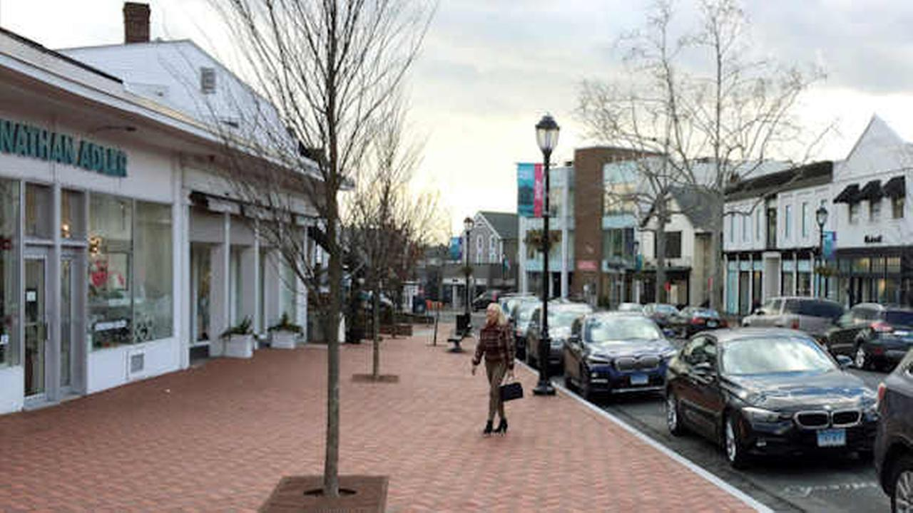 In this Jan. 26, 2017 photo, a woman walks near shops in downtown Westport, Conn. An essay contest on white privilege has stirred controversy (AP Photo/Michael Melia)