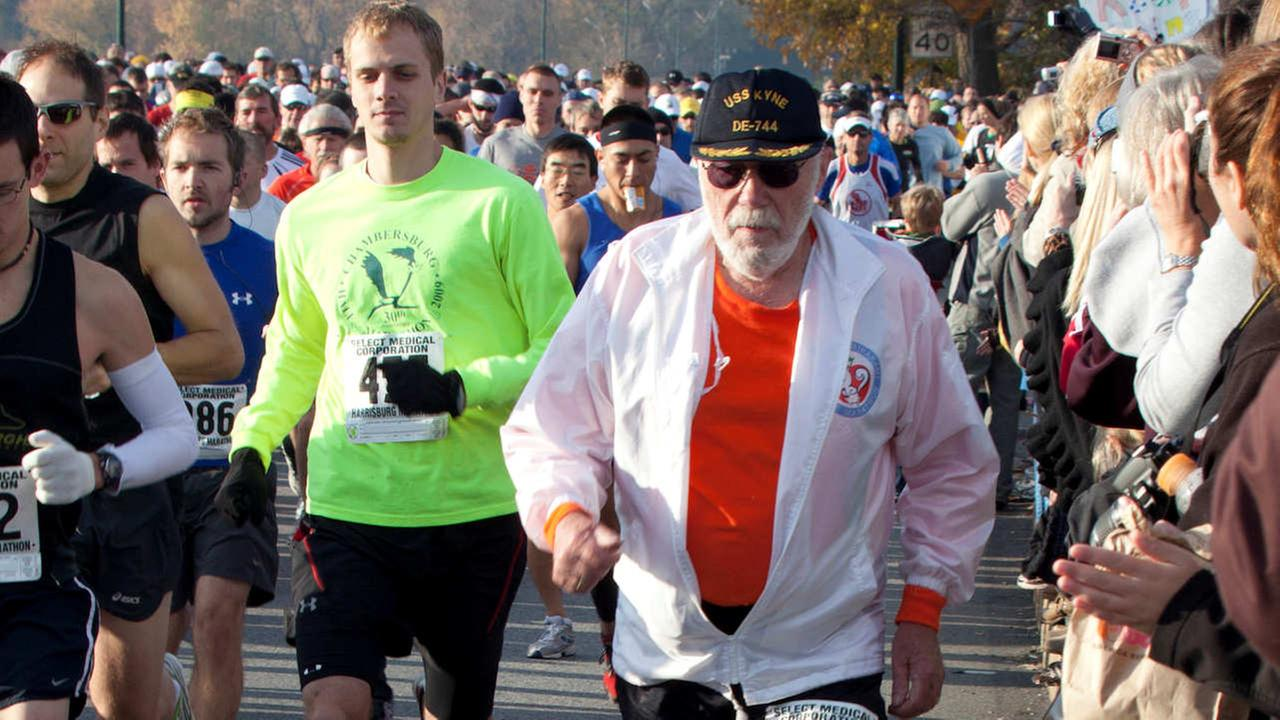 In this Nov. 14, 2010 file photo, Don McNelly (90), of Irondequoit, N.Y., competes in the 2010 Harrisburg Marathon in Harrisburg, Pa.