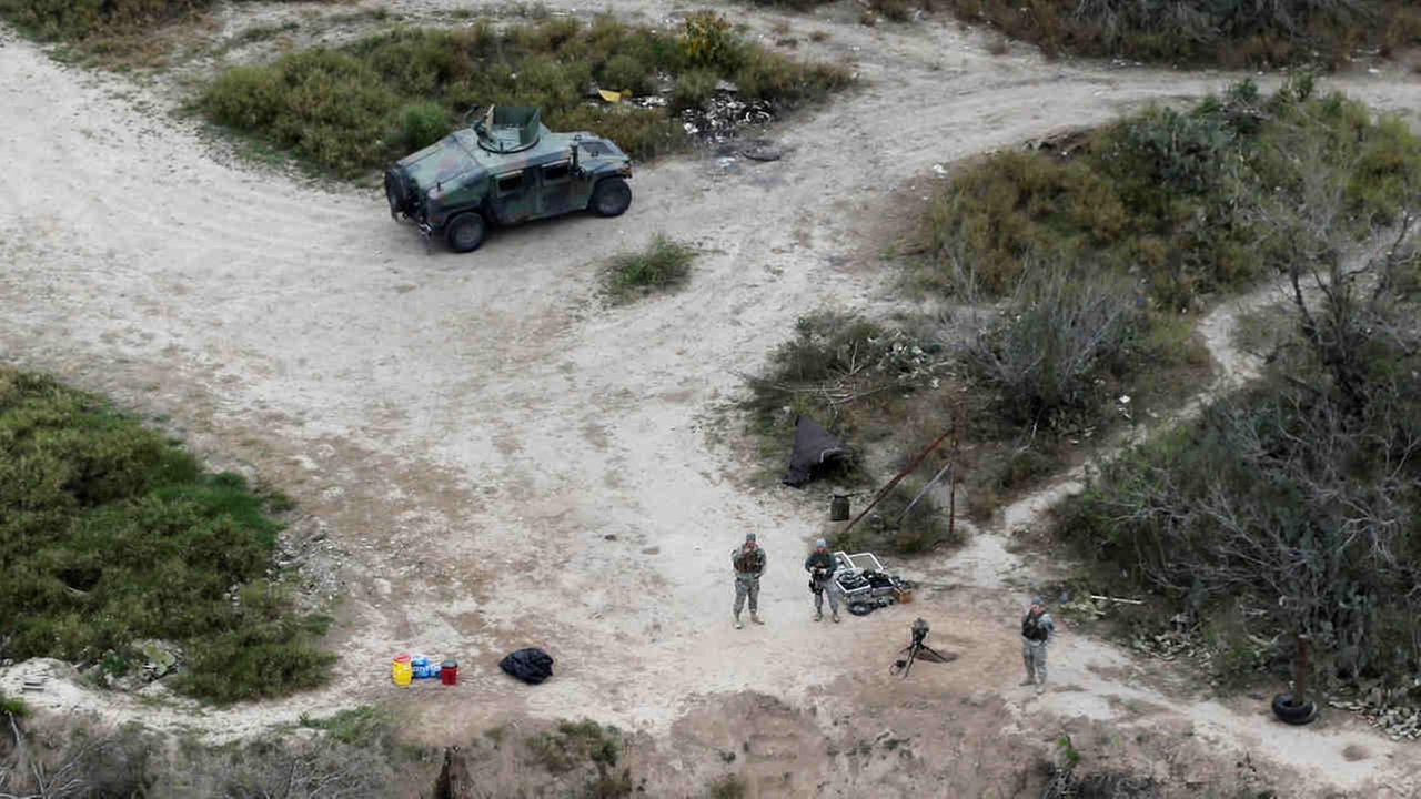 Members of the National Guard patrol along the Rio Grande at the Texas-Mexico border in Rio Grande City, Texas.