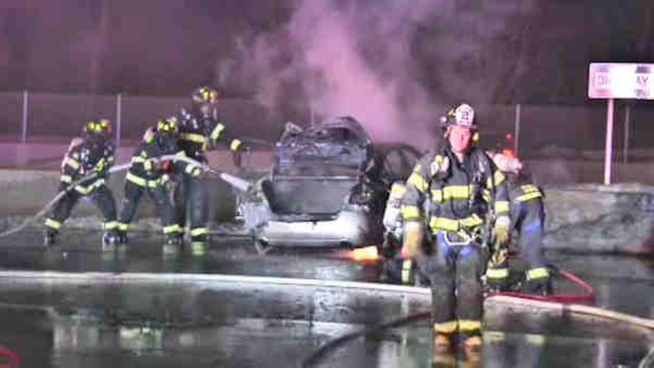 Suffolk County Police Highway Patrol rescued three people from a burning car on Long Island overnight.