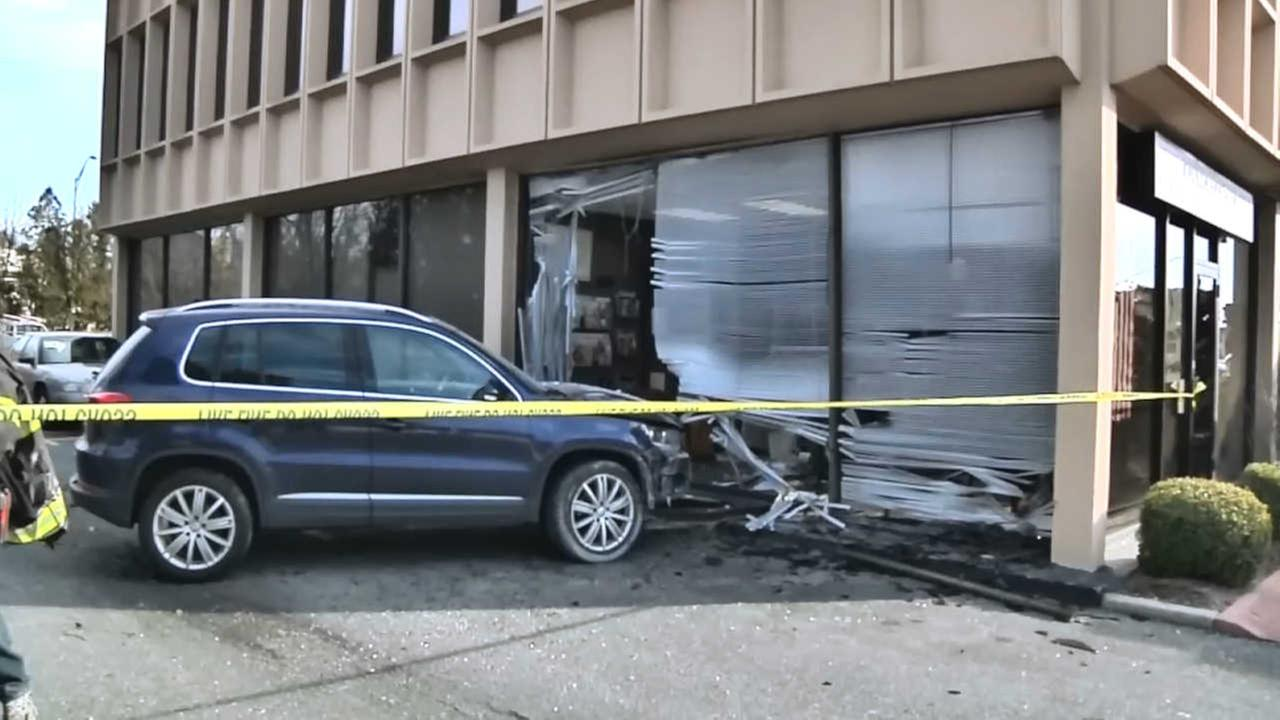 Police: Woman crashes through chiropractor's office while learning to drive in Melville