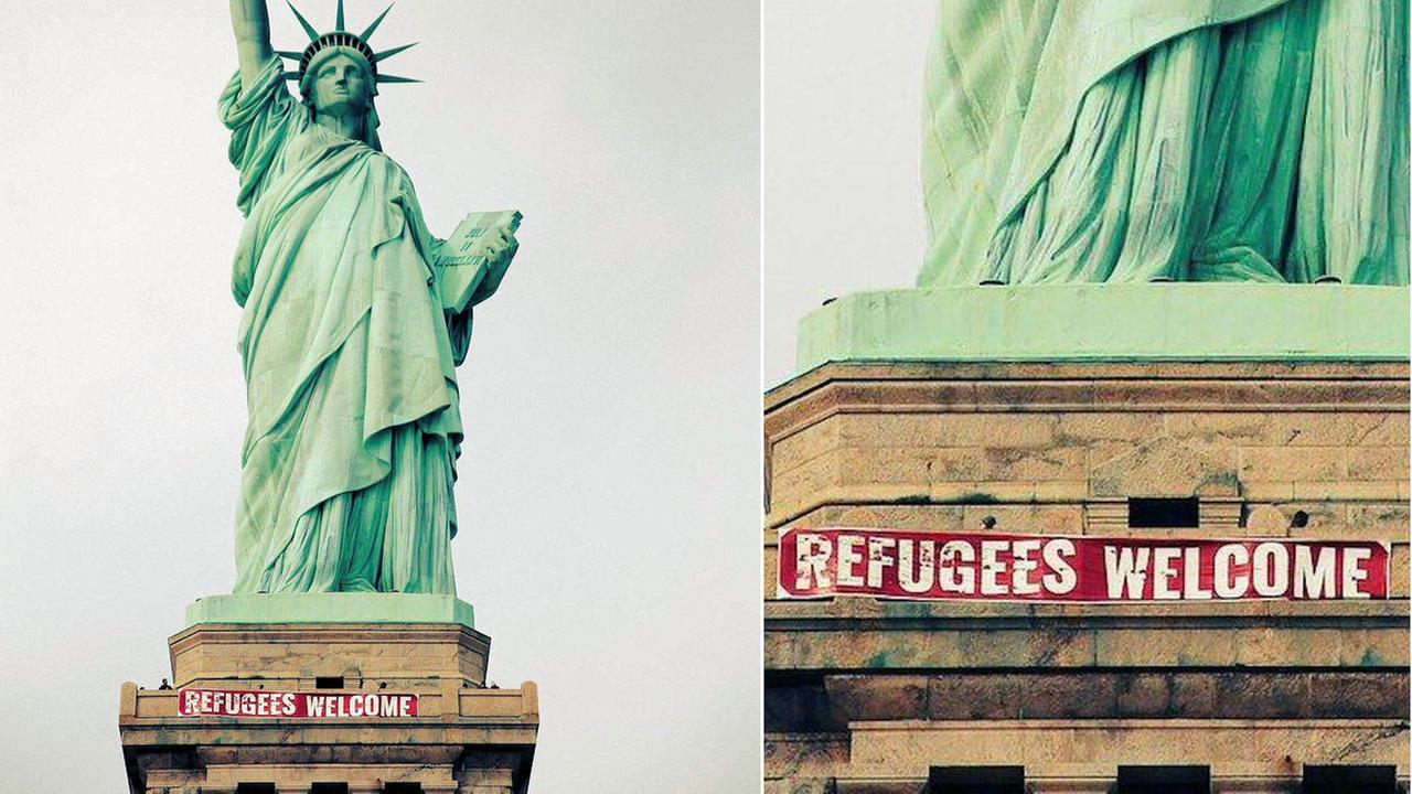 'Refugees Welcome' banner unfurled on Statue of Liberty